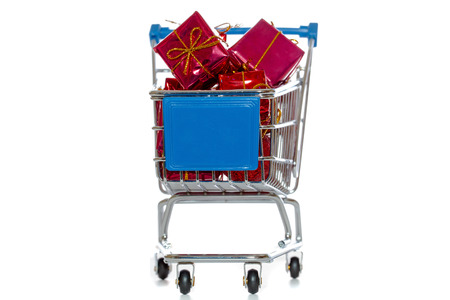 Shopping cart with presents isolated over white