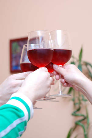 Picture of several people celebrating and drinking wine photo