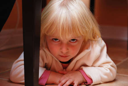 table: Picture of one little  girl lying on the floor