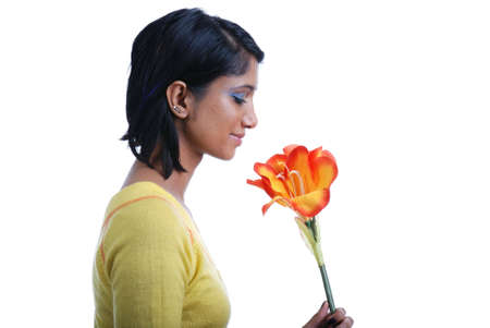 Picture of one girl and orange artificial flower on a white background photo