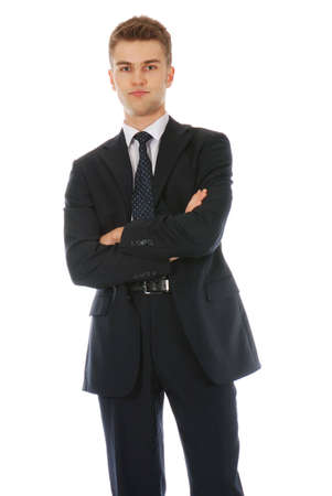 Young confident businessman standing and being skeptical photo