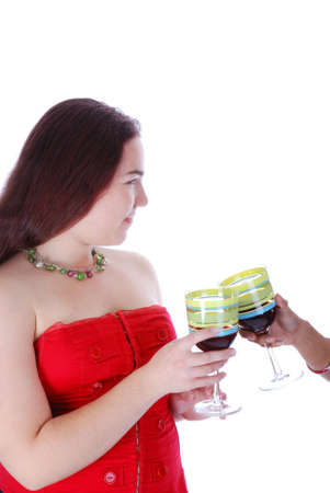 red corset: Girl in red corset holding a glass of wine Stock Photo