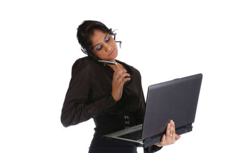 Picture of one girl working with laptop and cell phone