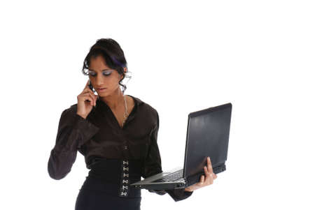 Picture of one girl working with laptop and cell phone - very serious Stock Photo