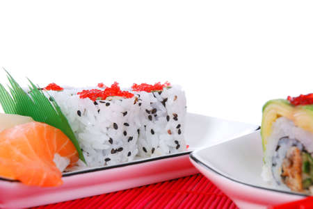 Set of rolls and sushi on several plates Stock Photo