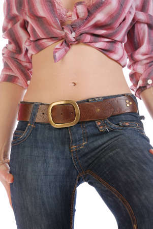 Closeup picture of a belly of a young sexy cowgirl