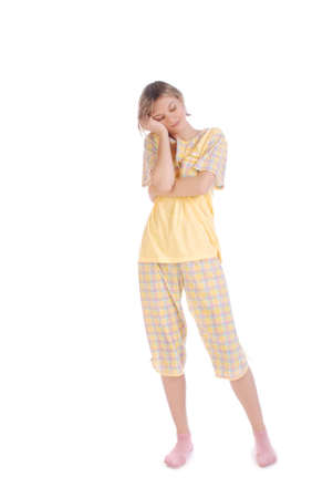 in pajama: Cute sleepy teenager isolated over white