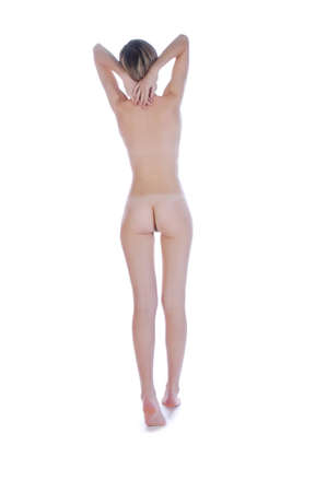 nude woman standing: Young beautiful girl standing isolated over white background Stock Photo