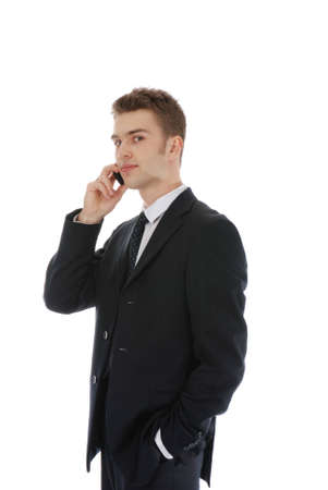 Young confident businessman isolated over white
