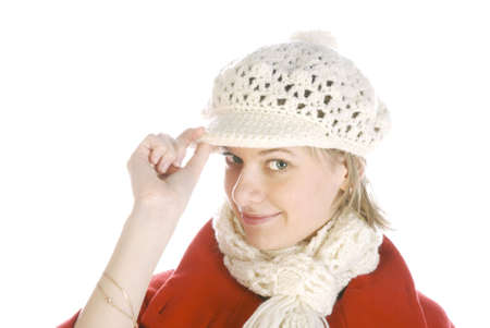 Young woman in a winter cap looking coquettishly isolated over white