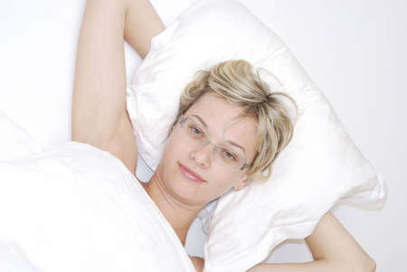 Beautiful young woman in the bed Stock Photo - 5497094
