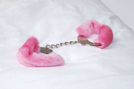 cuffs: One pair of fluffy pink hand cuffs Stock Photo