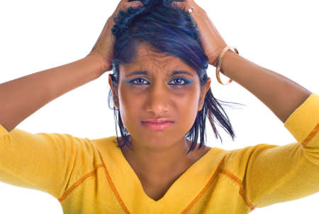 Brown girl being stressed - pulling her hair out photo