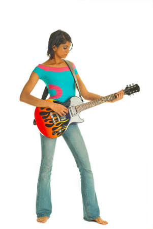 Young girl holding guitar and looking seriously