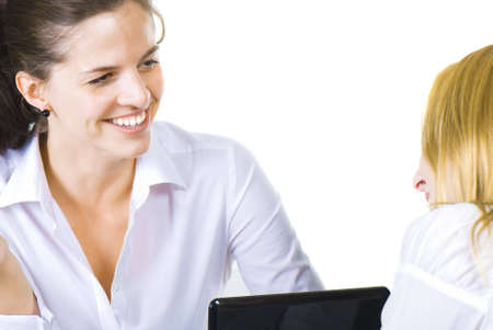 Two women talking in the office isolated over white photo