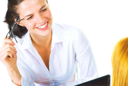 Two women talking in the office isolated over white Stock Photo - 6385428