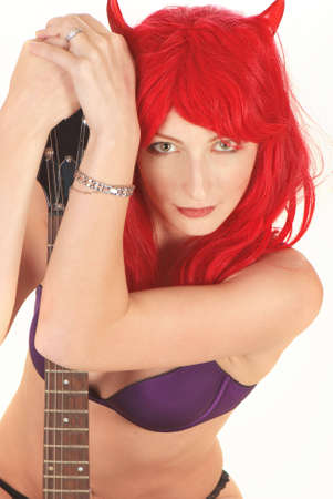 Sexy young woman with a guitar isolated over white photo