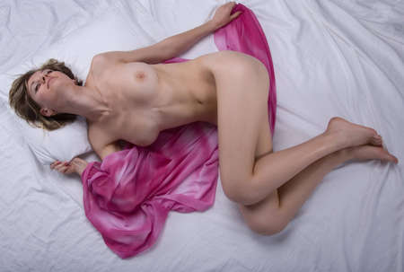 Young sexy woman on bed Stock Photo - 7508314