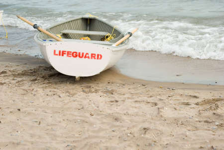 drown: lifeguards boat on a beach