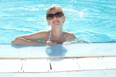 Young woman in the swimming pool. Vacation