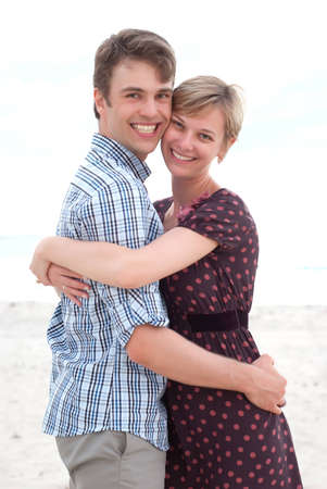 romance: Young happy couple on the beach Stock Photo