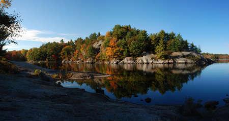 Lake landscape panorama during fall season