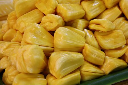 A lot of peeled jack fruit ready to eat on the table for sell