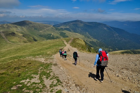 Tourists on the hiking trip in the Carpathian Mountains  photo