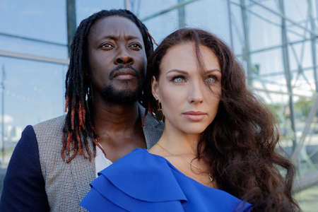 Close-up portrait, outdoors. mixed couple, African and European Caucasian. High quality photo