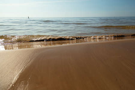 Sandy beach and gentle, soft wave, Baltic nature. High quality photo