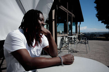African man portrait, Long hair, pondered, Summer day, outdoors. High quality photo