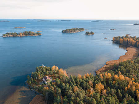 The coastline of the Gulf of Finland and an island in the sea Helsinki, Vuosaari .. Sunny autumn day. Nature and landscape of Scandinavia. Aerial photo from drone. High quality photo