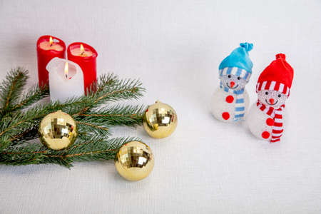 Decorative snowmen for the new year, candles, fir branch, medical mask. Concept, Christmas in the coronavirus epidemic, congratulate friends, but stay in corantin. High quality photo