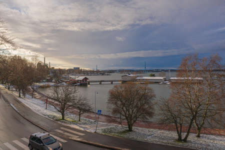 Embankment in Helsinki, Finland, in November, streets in the snow. High quality photo Фото со стока