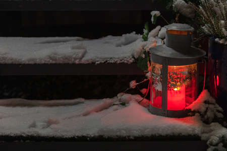 Flashlight with burning candles in the snow. Concept, winter, new year, christmas. High quality photo