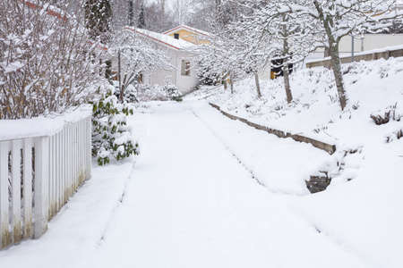 Houses in the suburbs. Winter in Finland Street and houses covered with beautiful snow. High quality photo