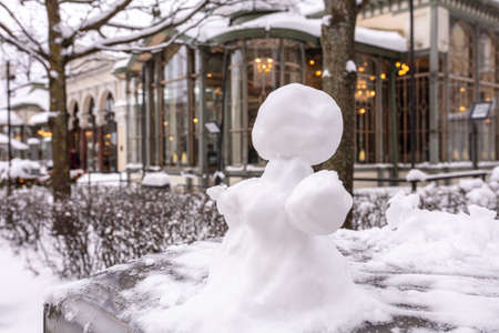 Snowman, snow woman molded from snow. Snowy winter concept. High quality photo