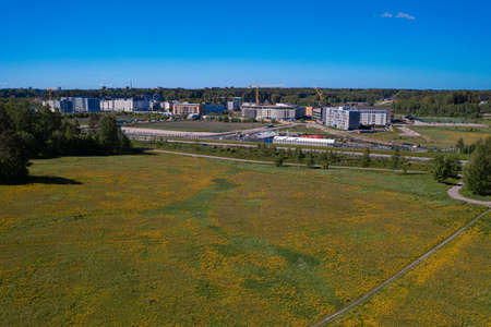 Espoo, Finland 30 May 2021 Urban area in the distance. Path on the dandelion field Top view. There is room for text. Photo from the drone. Stock fotó