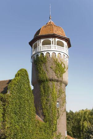 an old stone tower spire plants Kaliningrad Oblast city of Svetlogorsk