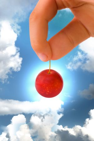 plum cherry small red delicious nga stark white background is blurred como juicy fresh healthy food tasty and a little more against the sky blue baby keeps a childs hand the sun behind the object