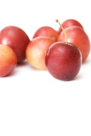 small plum  cherry red delicious nga stark white background is blurred como juicy fresh healthy food tasty and a little more Stock Photo