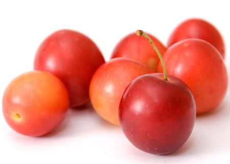 small plum  cherry red delicious nga stark white background is blurred como juicy fresh healthy food tasty and a little more Stock Photo - 5414843