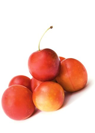 small plum  cherry red delicious nga stark white background is blurred como juicy fresh healthy food tasty and a little more