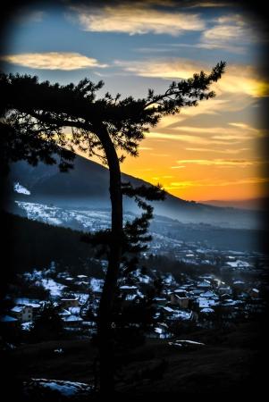 Sunset over village Stock Photo - 19674224