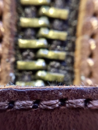 stitch: Close up of brown leather boot with zip Stock Photo