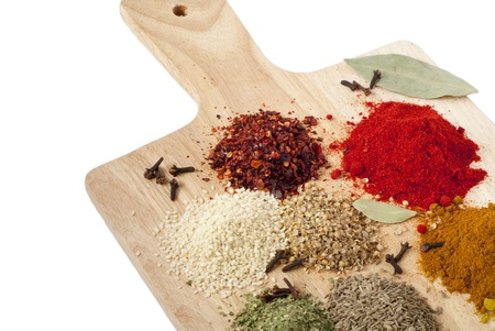Different spices on wooden desk Stock Photo - 11174146