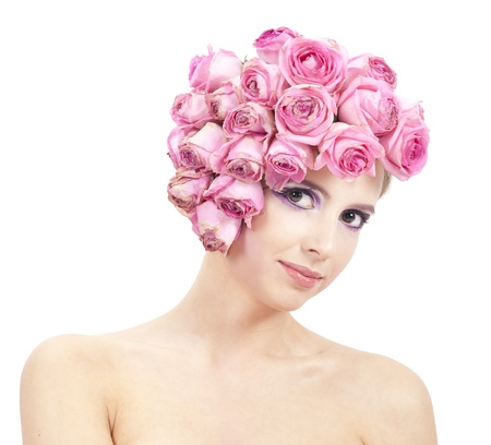 young beautiful woman with pink flowers on her head Stock Photo - 11385681
