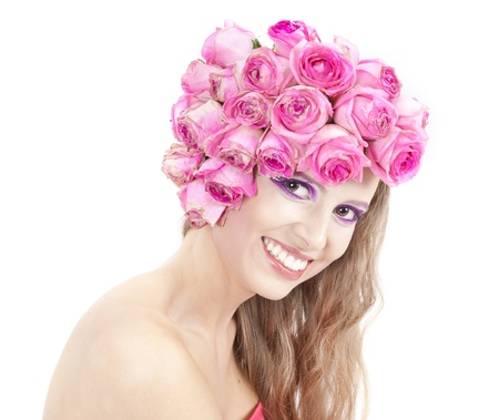young beautiful woman with pink flowers on her head Stock Photo - 11385697