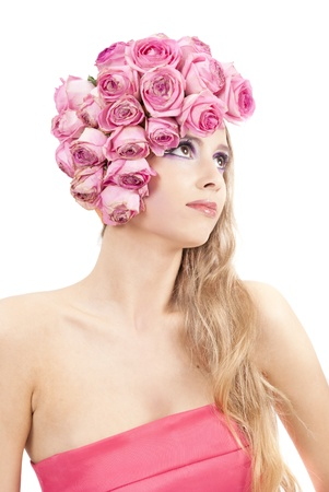 young beautiful woman with pink flowers on her head and in pink dress Stock Photo - 11385741