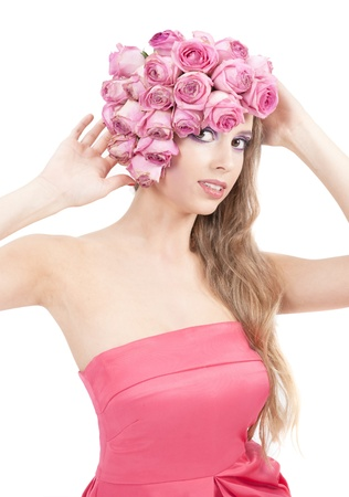 young beautiful woman with pink flowers on her head and in pink dress Stock Photo - 11385724